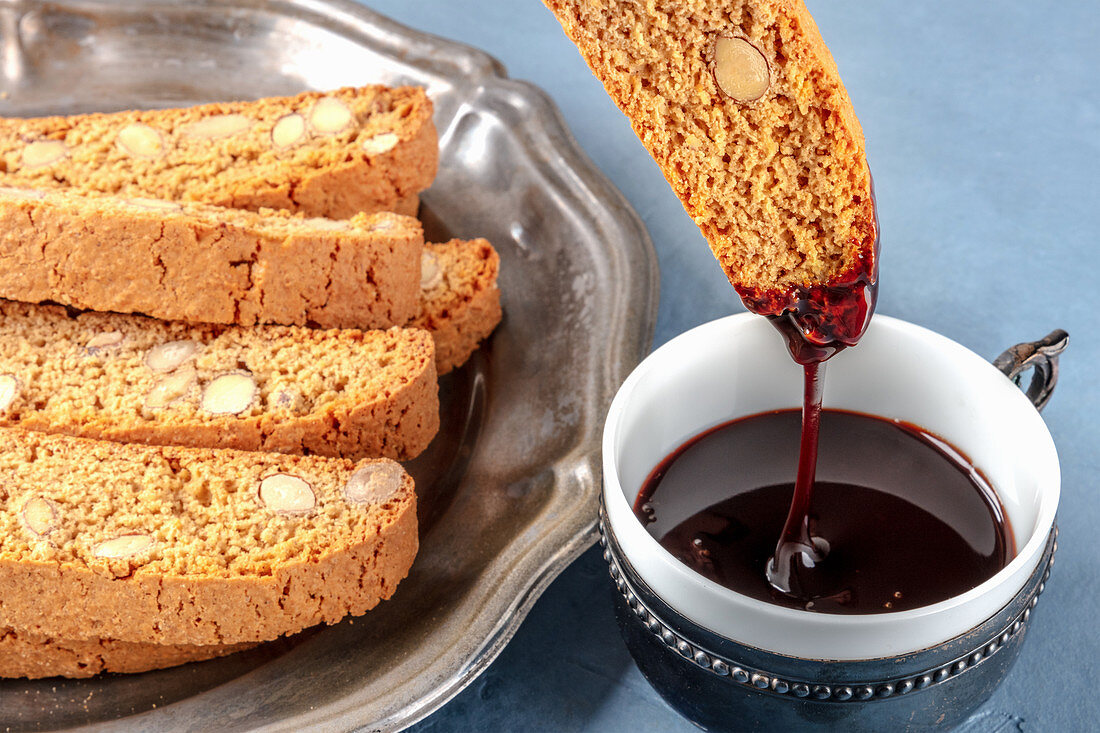 Biscotti, traditional Italian almond biscuits, dipped in a cup of hot chocolate