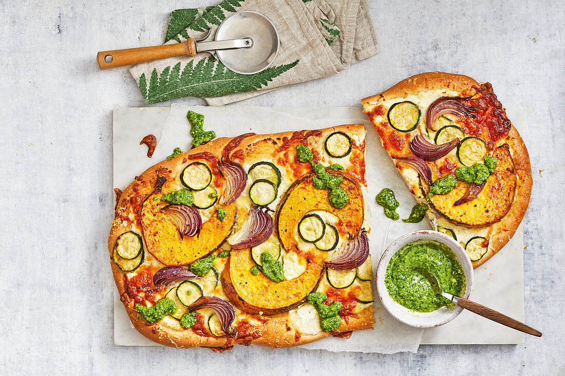 Pumpkin and zucchini pizza with basil dressing