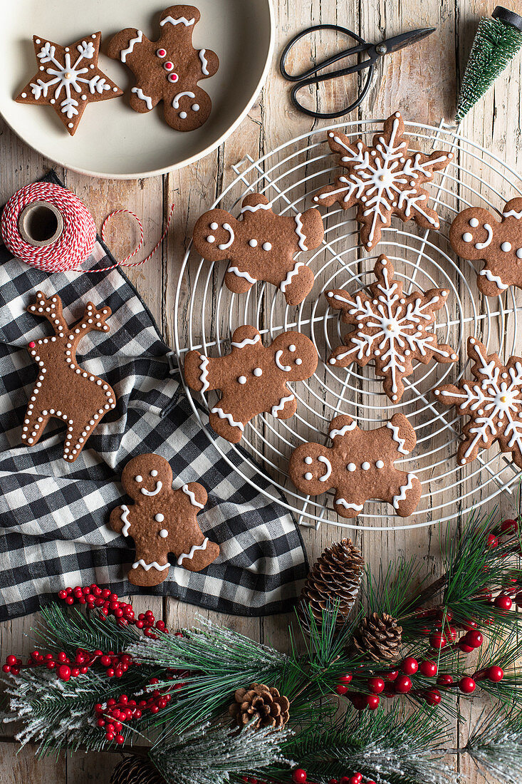 Traditional homemade gingerbread with icing placed on wooden table for Christmas