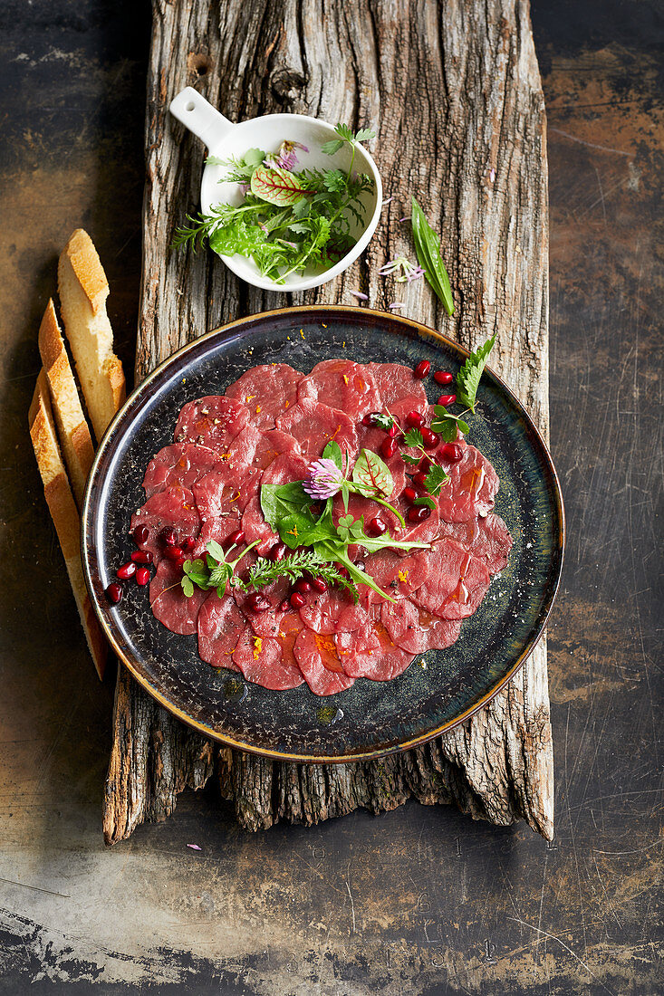 Venison carpaccio with a wild herb salad