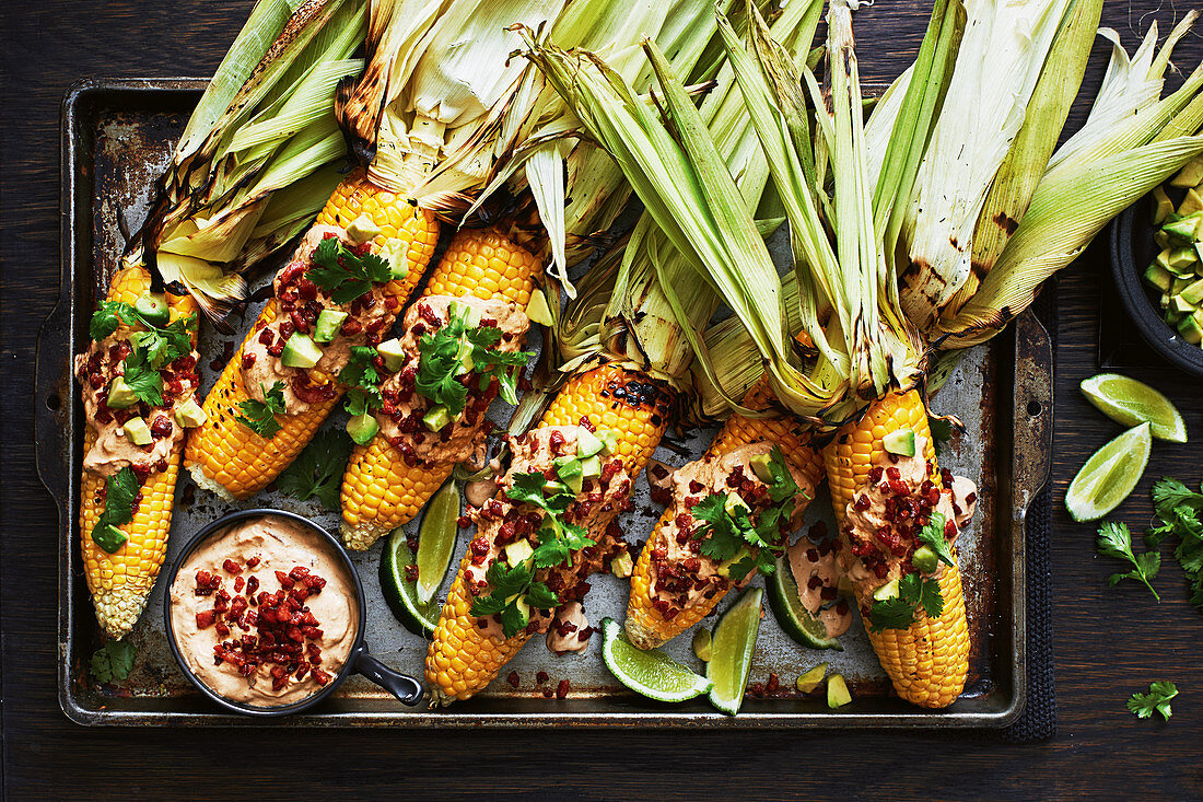 Mexican-style loaded corn cobs with chorizo and chipotle sauce