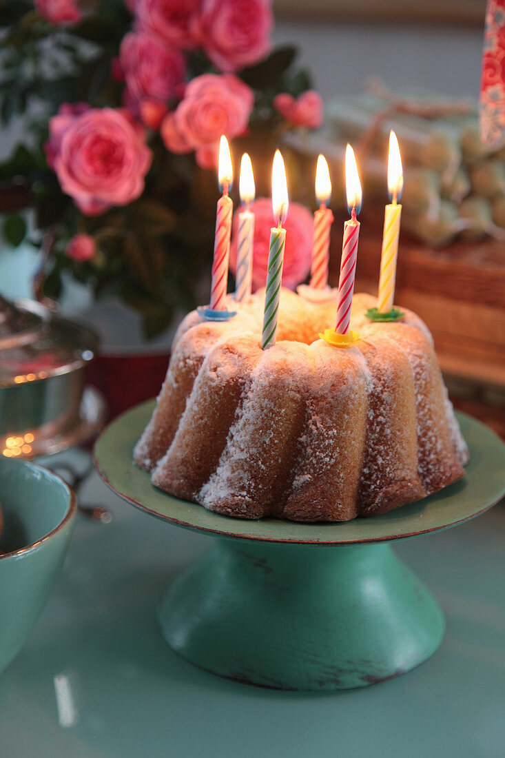 Birthday cake with burning candles