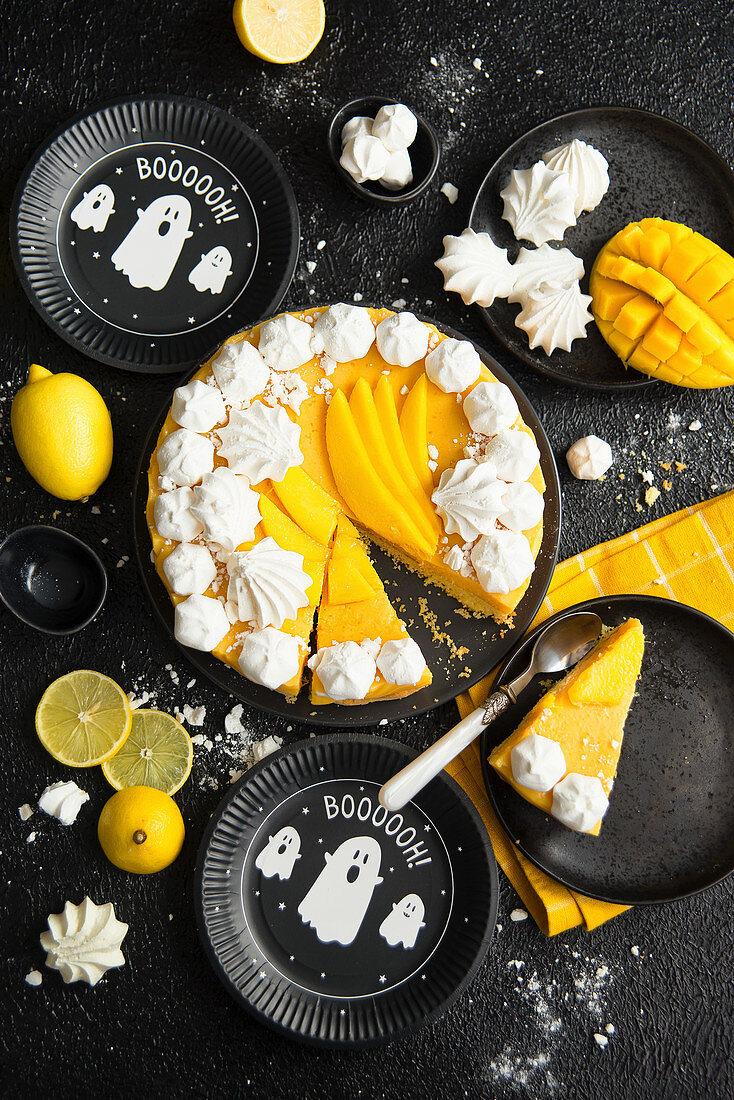 Halloween mango cheesecake with meringues