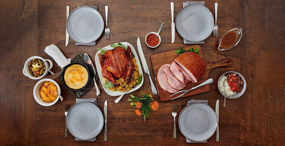 Festive menu with ham and poultry roast, side dishes and sauces