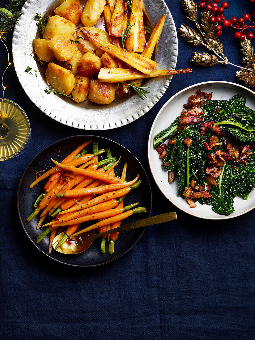 Roast potatoes and parsnips, Buttered black cabbage, Simple buttered carrots