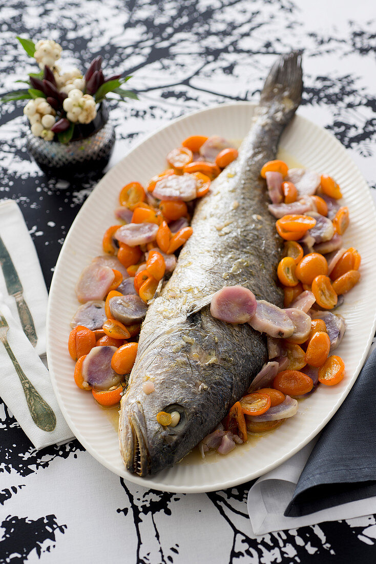 Alder fish in champagne sauce with potatoes, kumquat and fennel seeds