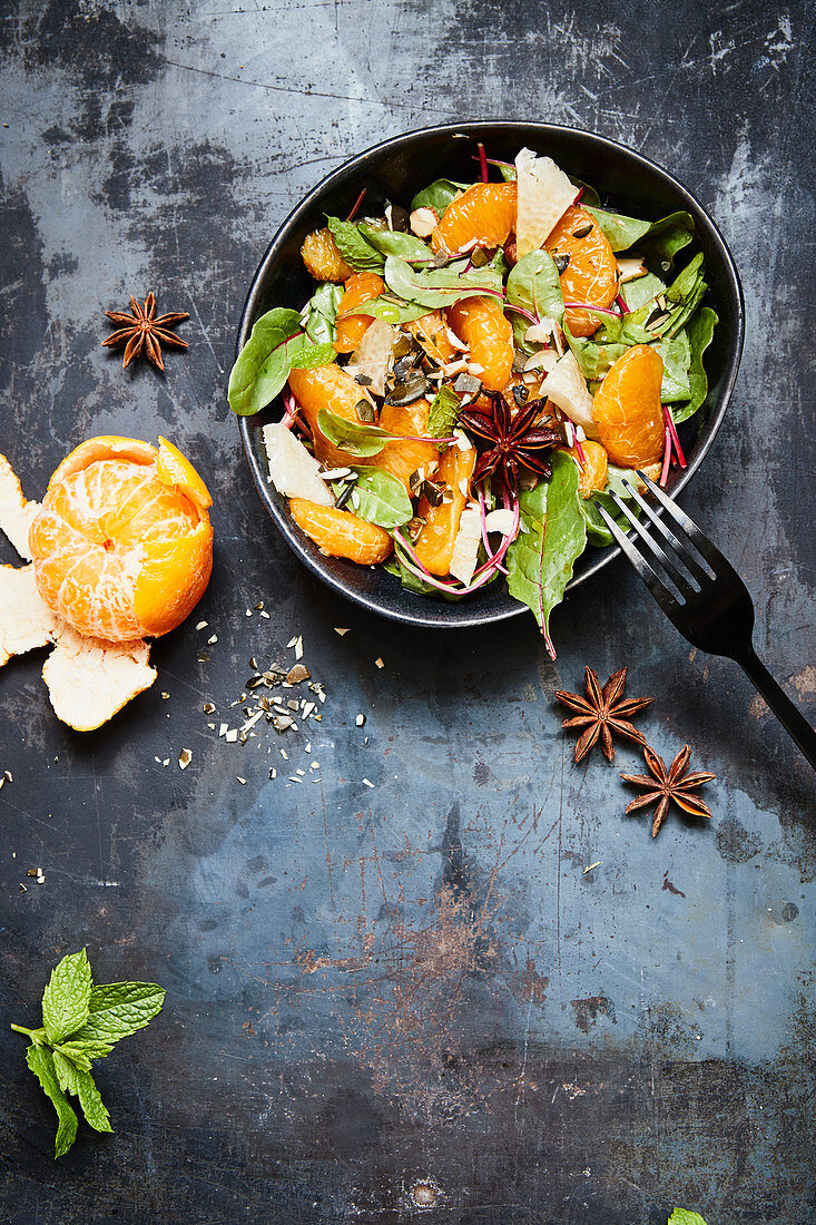 Mandarin and pomelo salad with young Swiss chard and star anise
