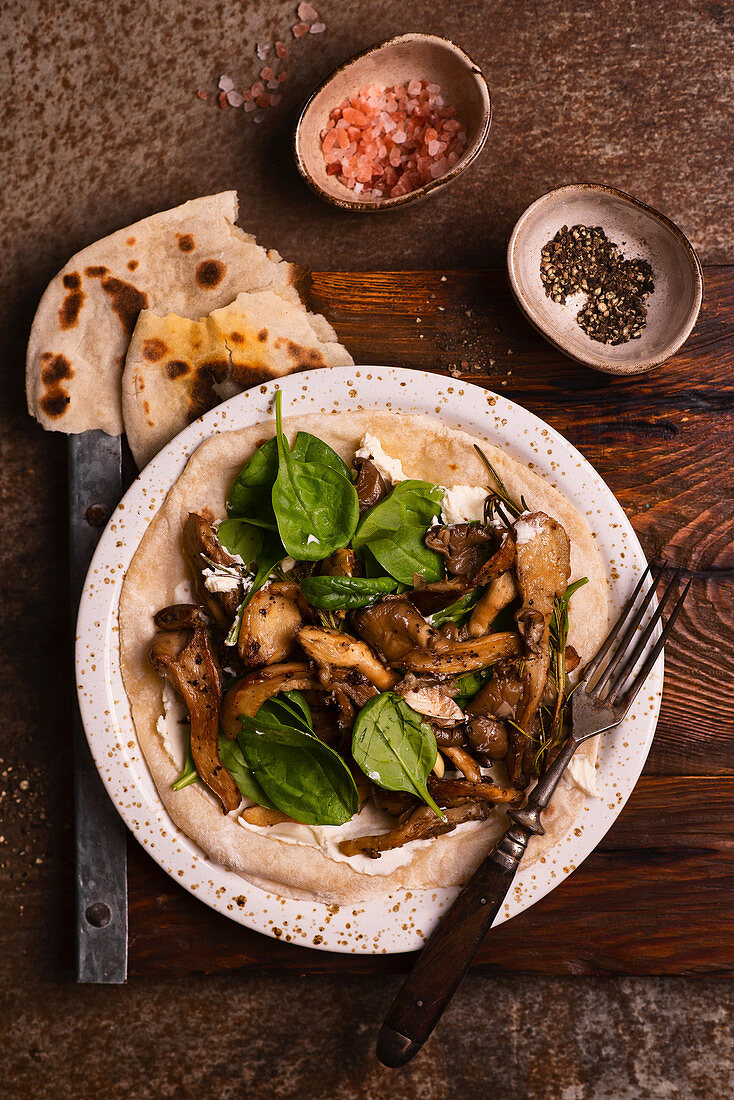 Flat bread with goat's cheese, fried oyster mushrooms and spinach