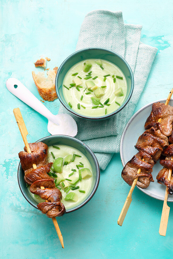 Avocado soup with beef fillet skewers