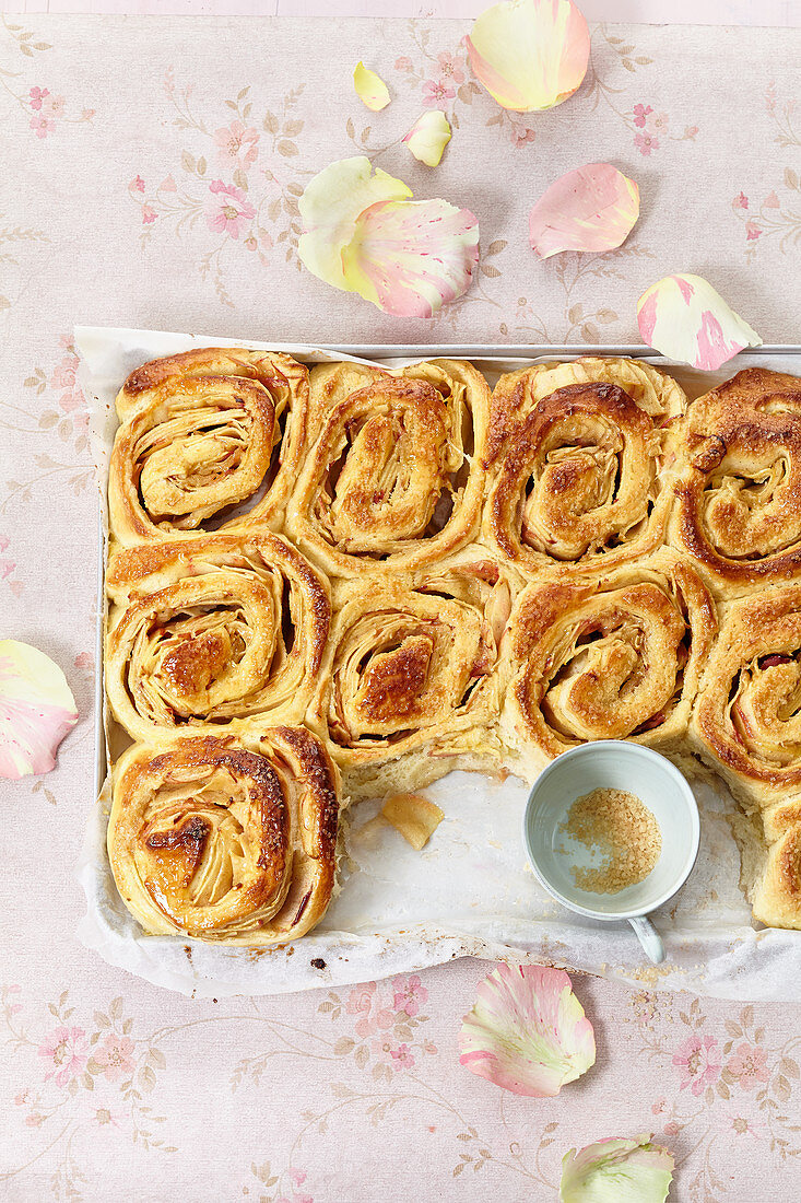 Apple and cinnamon yeast rolls on a tray