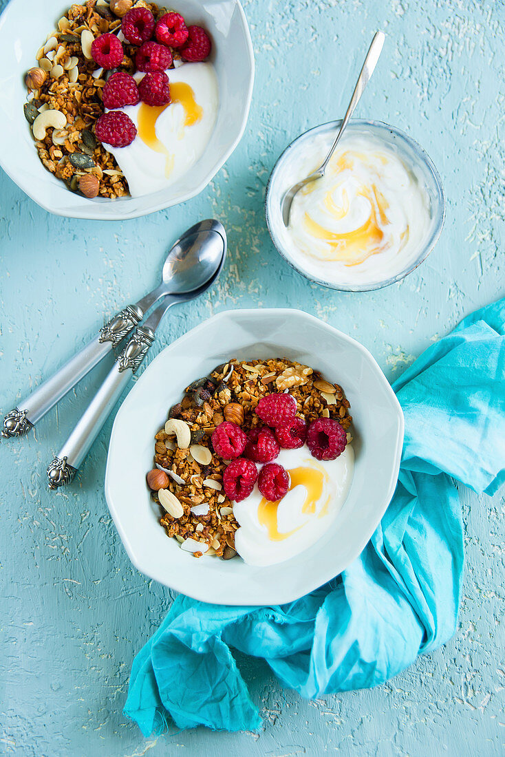 Almond granola with cashew nuts, yoghurt, honey and raspberries