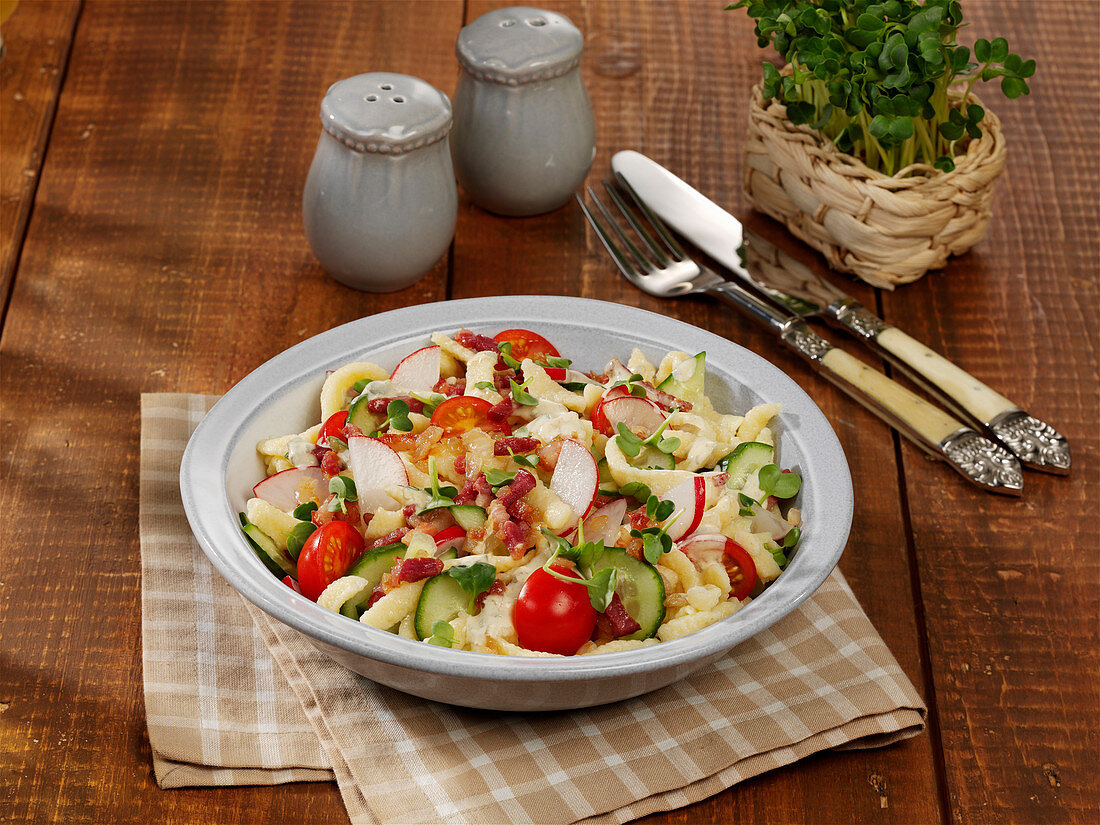 Spätzle (soft egg noodles) salad with cucumber, capers and radishes