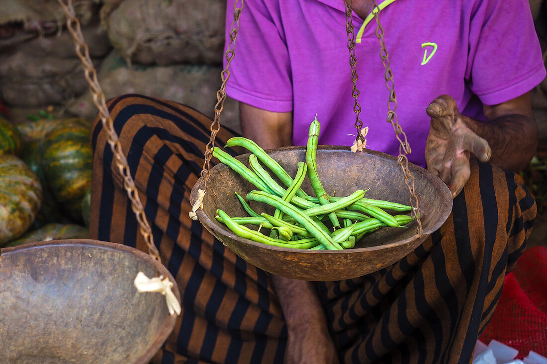 Green beans being weighed at a market stall in Sri Lanka