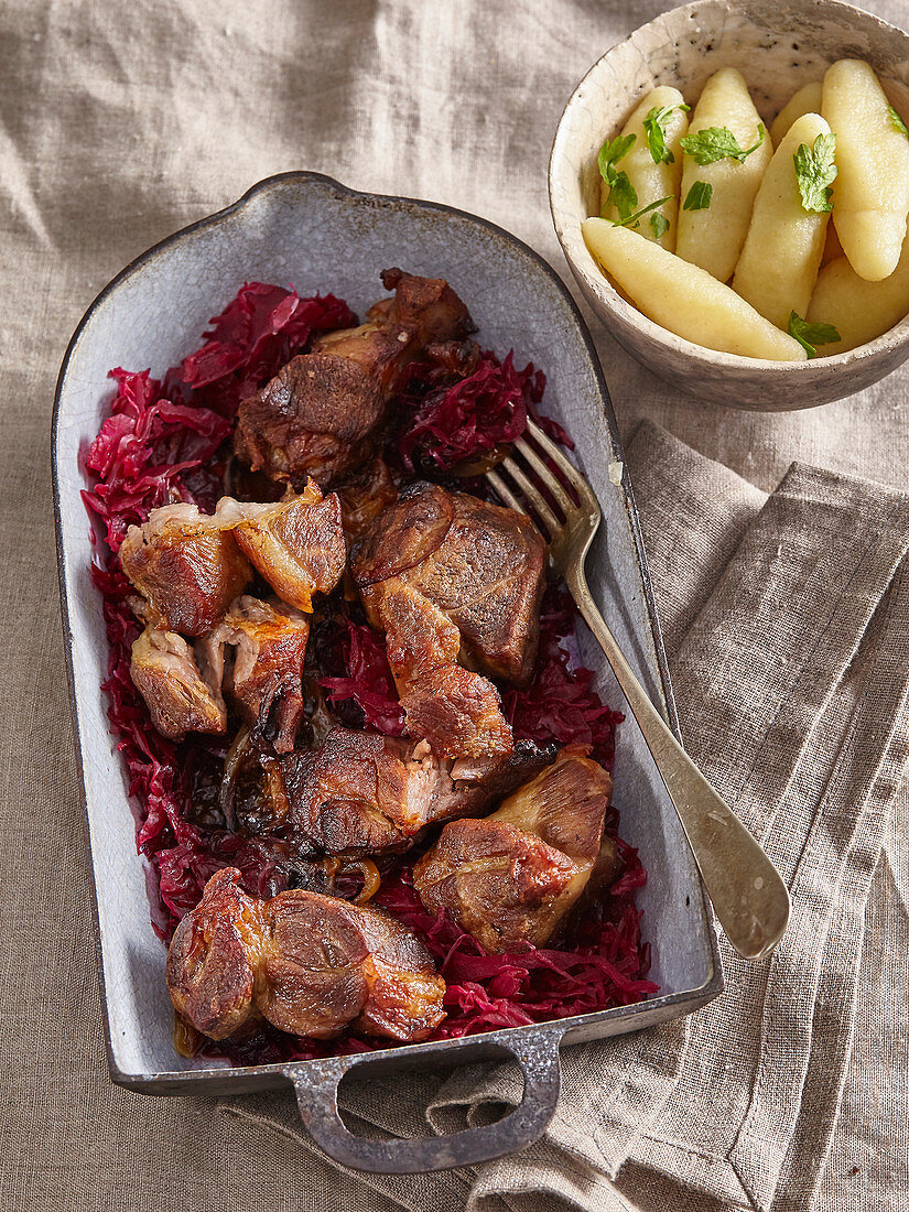 Pork neck with red cabbage and apples