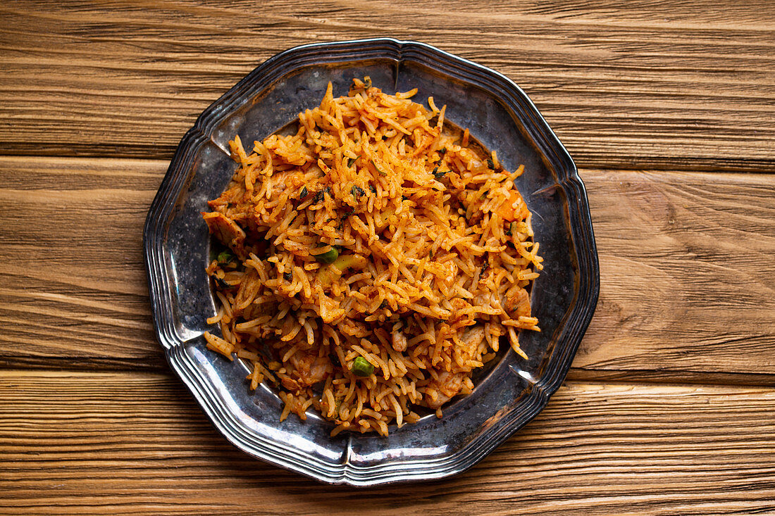 Indian pilaf with biryani rice on wooden rustic background