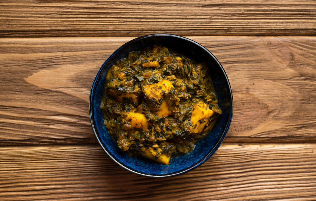 Indian Palak paneer on wooden rustic background