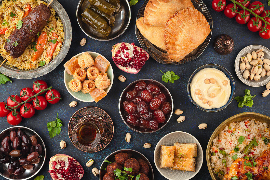 Ramadan kareem Iftar party table with assorted festive traditional Arab dishes, sweets, dates