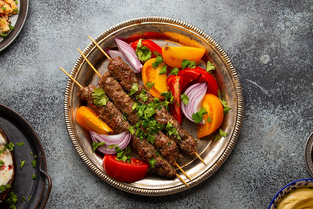 Delicious meat kebab with fresh vegetable salad