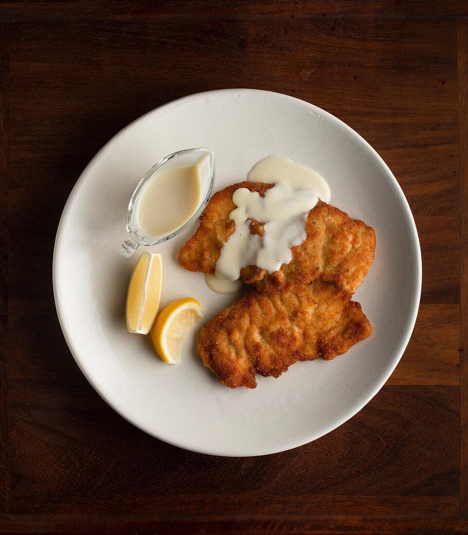 Chicken Schnitzel and white sauce