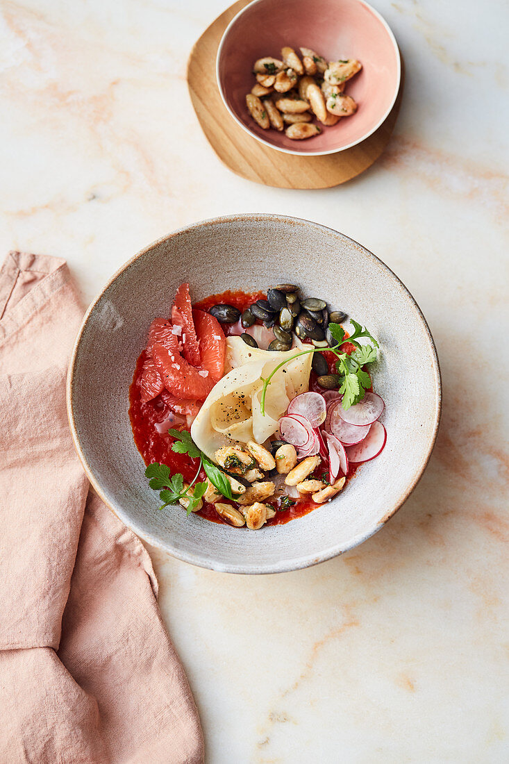 Celeriac with almonds, radishes, pink grapefruit and pepper sauce