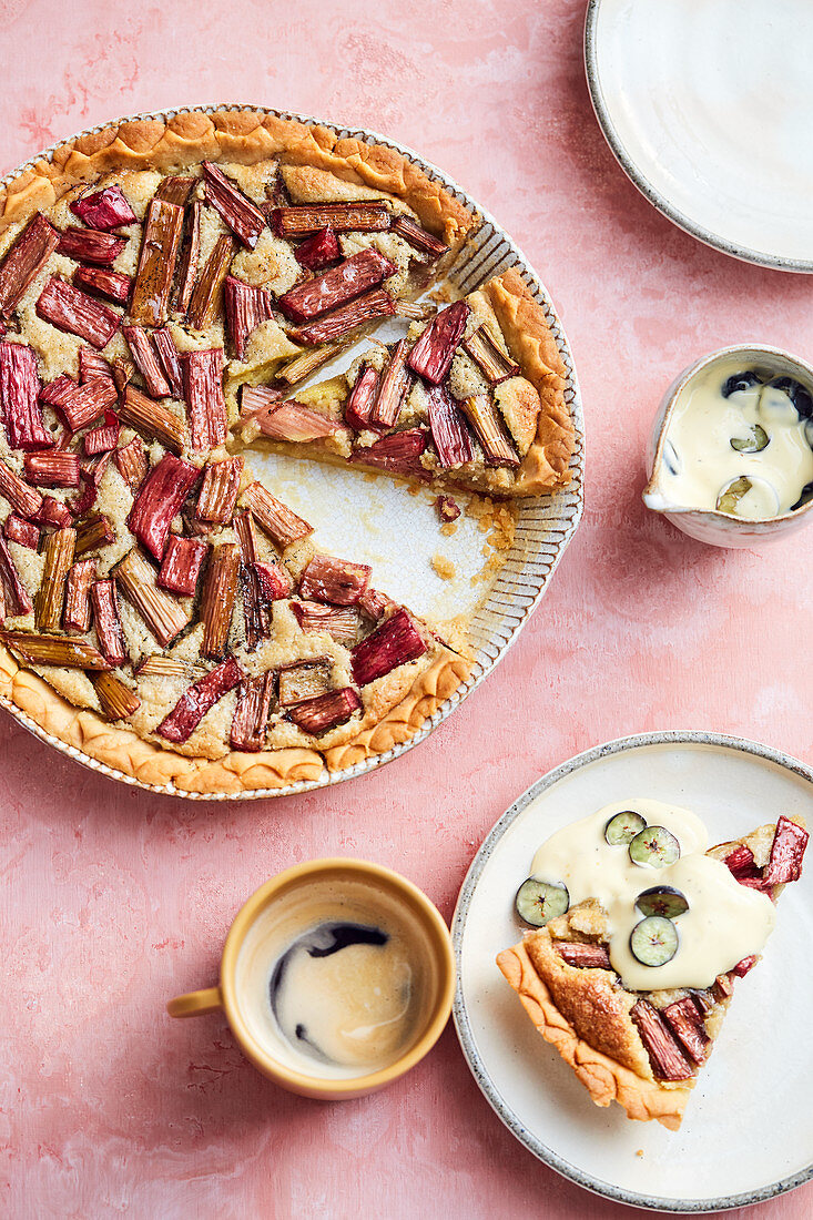 Almond and rhubarb tart with blueberry and vanilla sauce