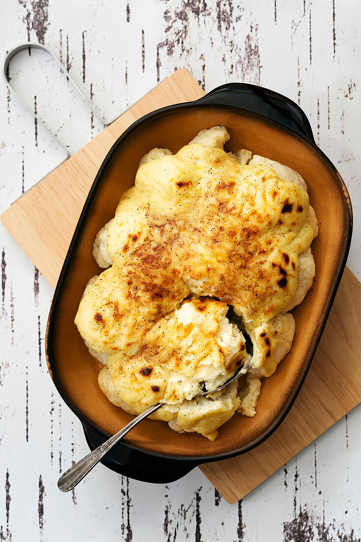 Cauliflower with cheese sauce in a baking dish