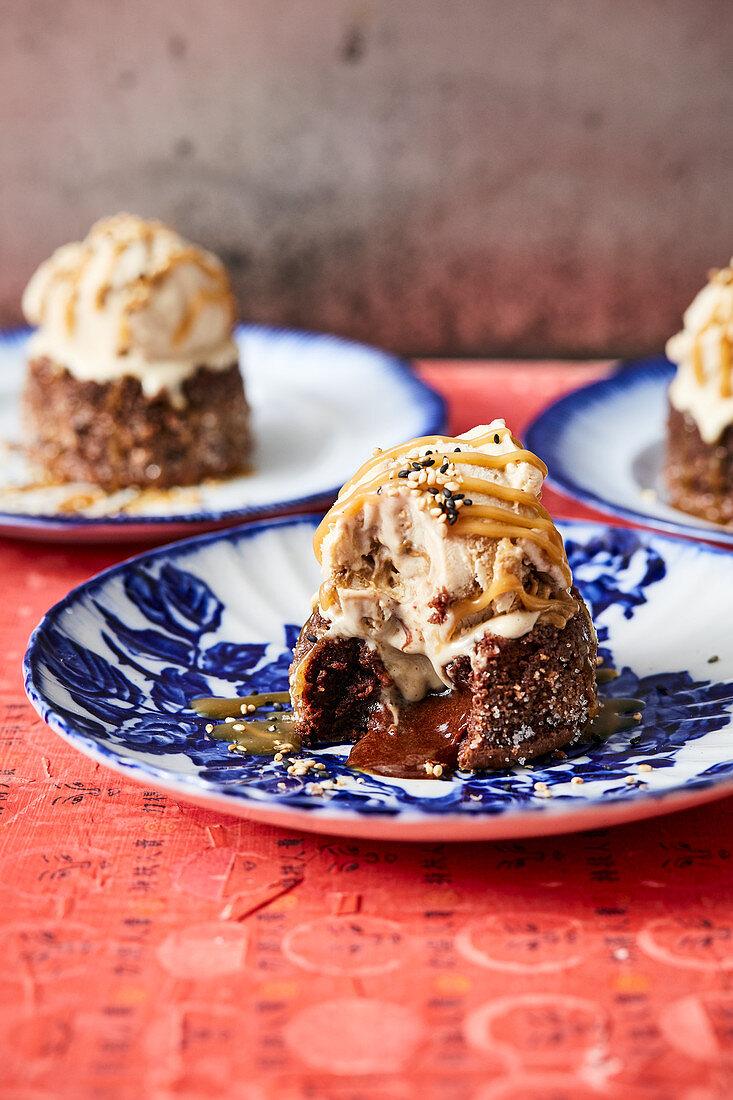 Warm chocolate cake with miso caramel sauce and sesame ice cream (Asia)