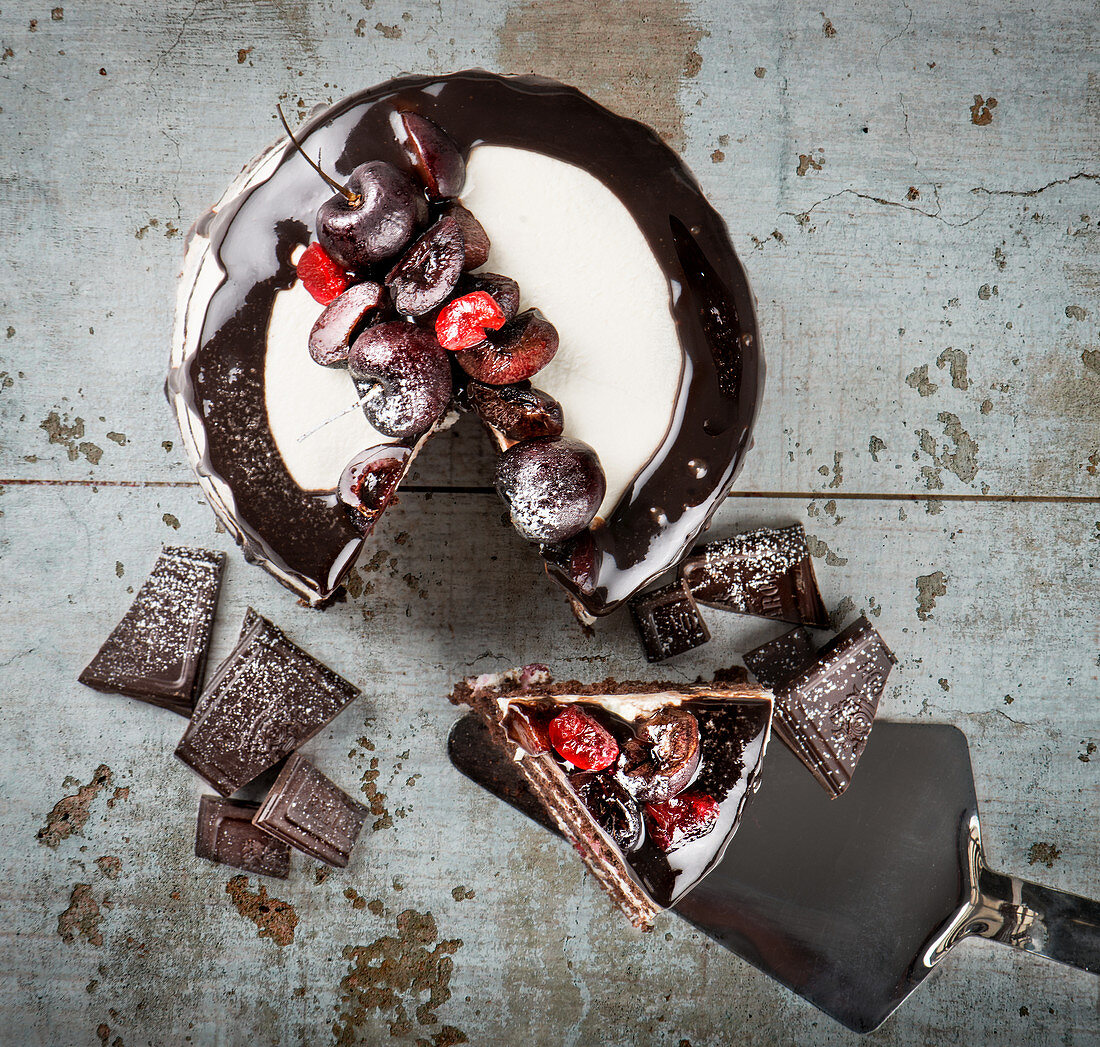 Black forest cake with chocolate biscuits and cream with cherries