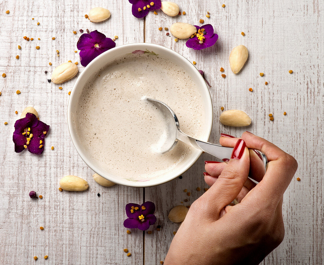 Eating tasty almond cream soup