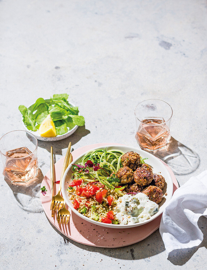 Barley and couscous tabbouleh with meatballs, tzatziki and zoodles