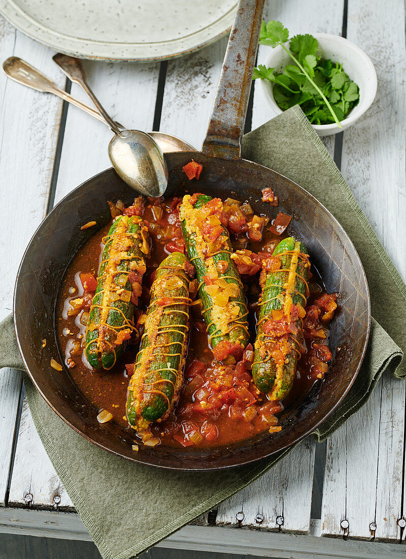 Stewed cucumbers filled with couscous in a rustic pan