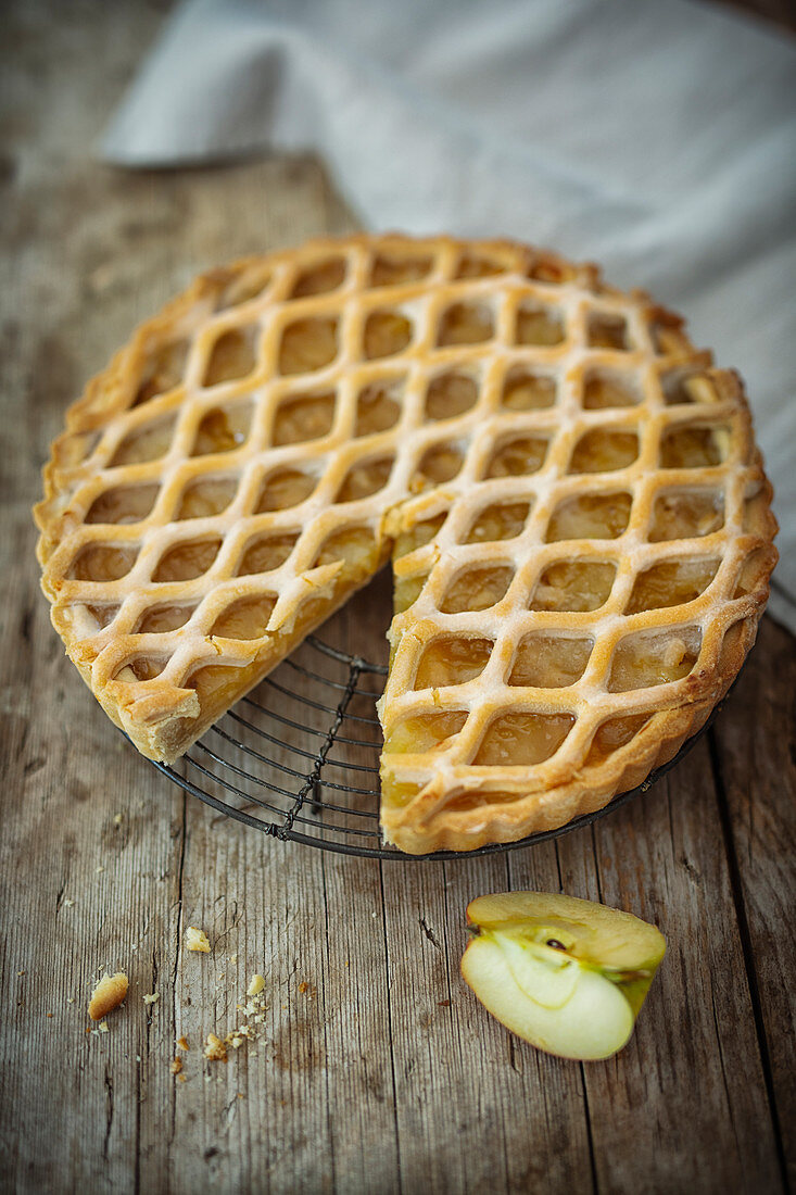 Vegan apple tart with pine nuts and a lattice