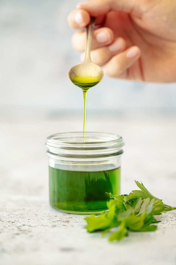 Homemade herb oil with parsley and lovage (vegan)