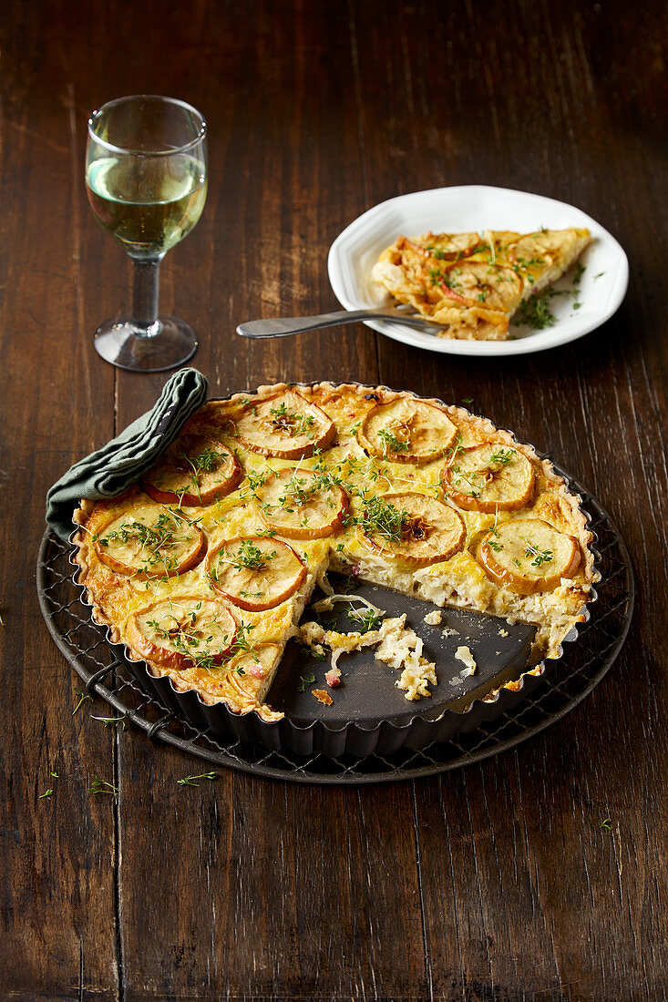 Onion cake with cress, sliced