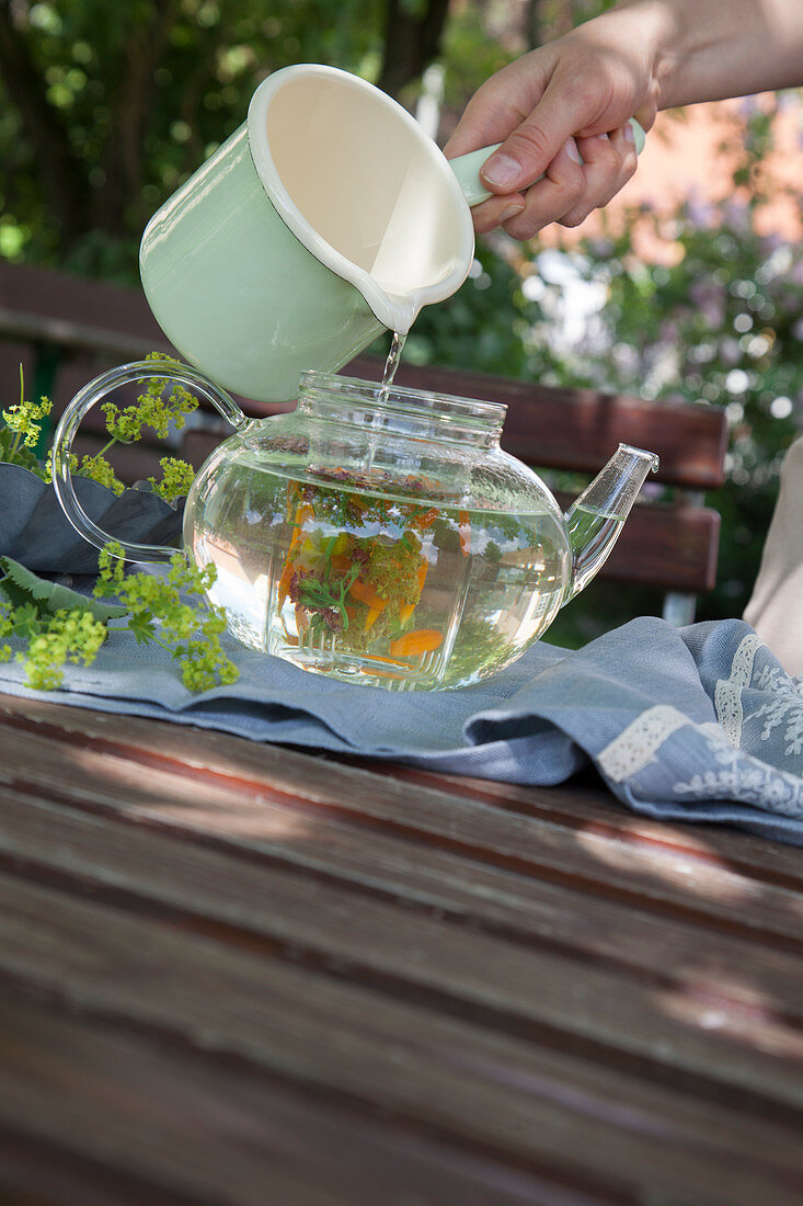 Brewing flower tea in a glass jug