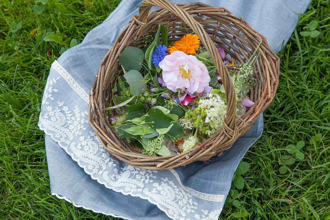 Different edible flowers in a basket