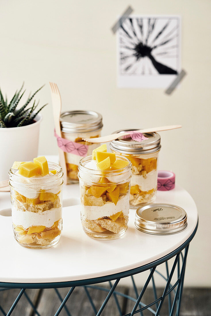 Cheesecake with Mango in take away jars