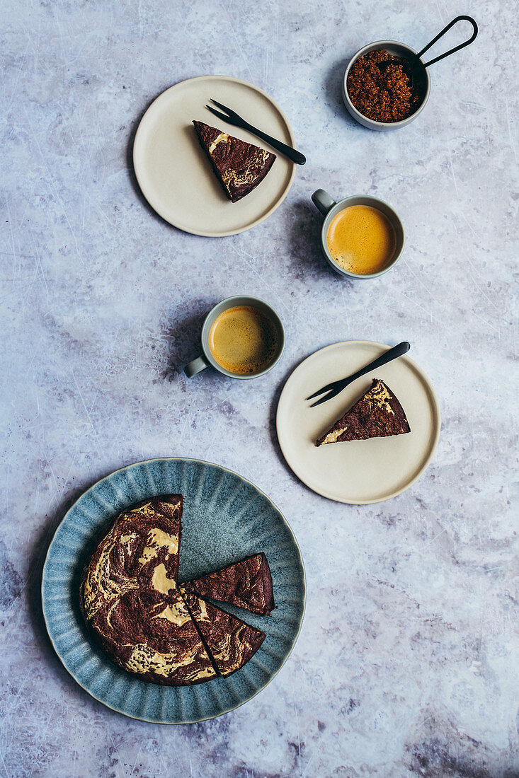 Tahini Brownies baked in round cake tin served with coffee