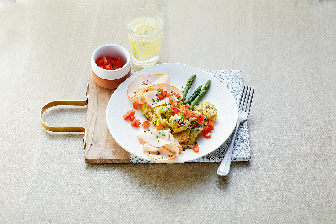 Scrambled asparagus and eggs with turkey breast and amaranth pops