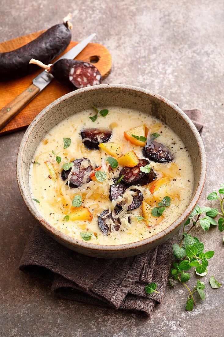 Potato stew with sauerkraut and black pudding