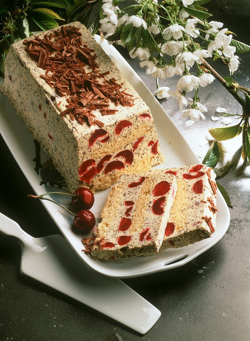 Loaf-shaped ice cream gateau with poppy seeds & cherries