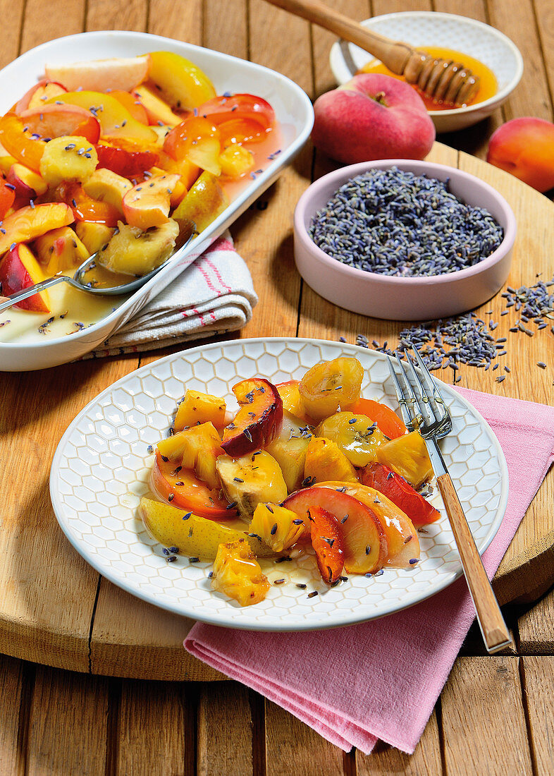 Warm fruit with lavender flowers and honey
