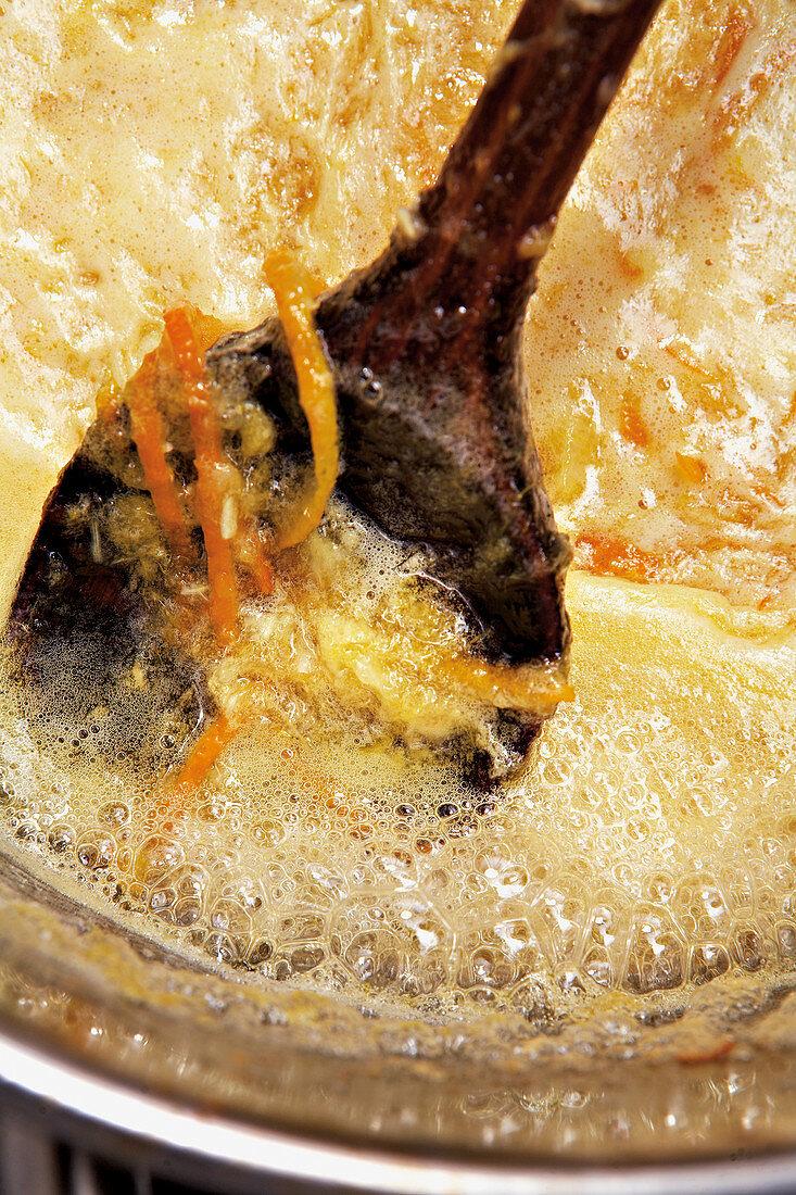 Reducing orange jam with zest