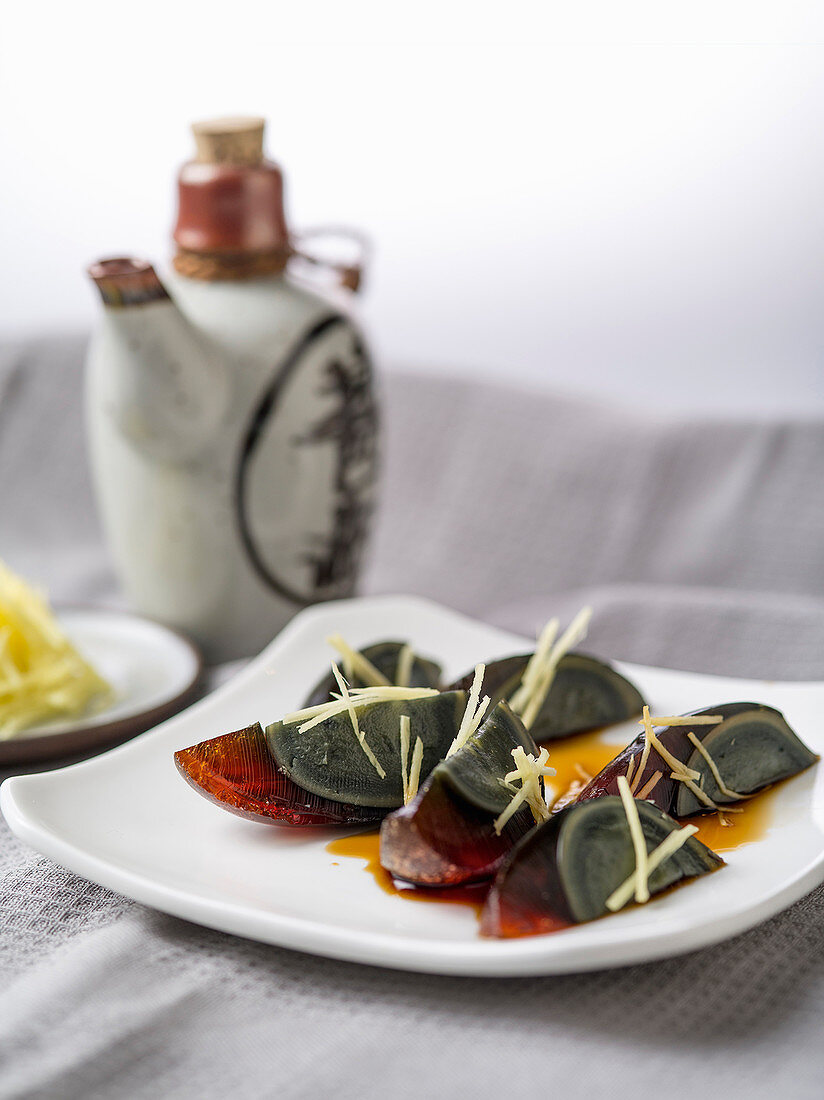 Pidan (thousand year-old eggs) with ginger and soy sauce, China