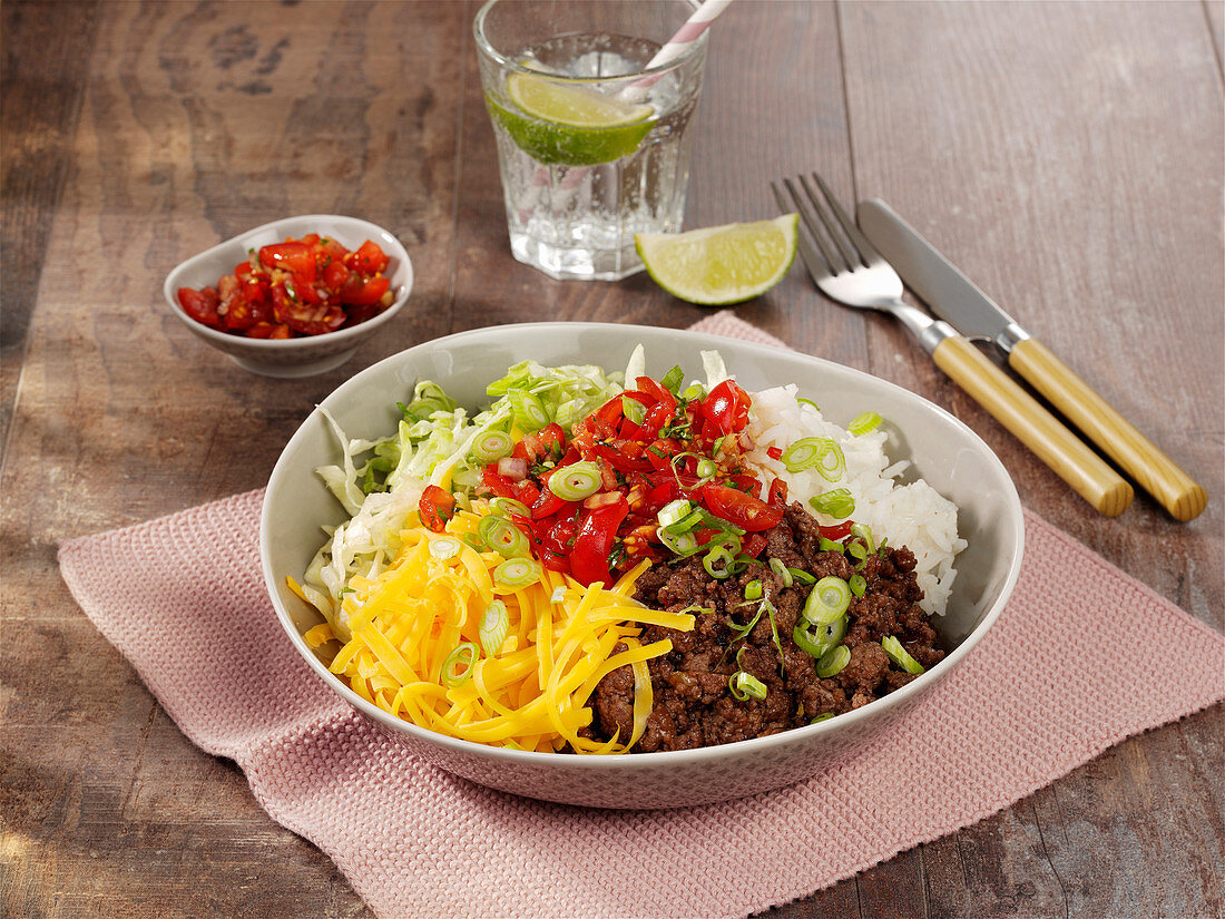 Forkable beef bowl with rice, tomatoes and Cheddar cheese