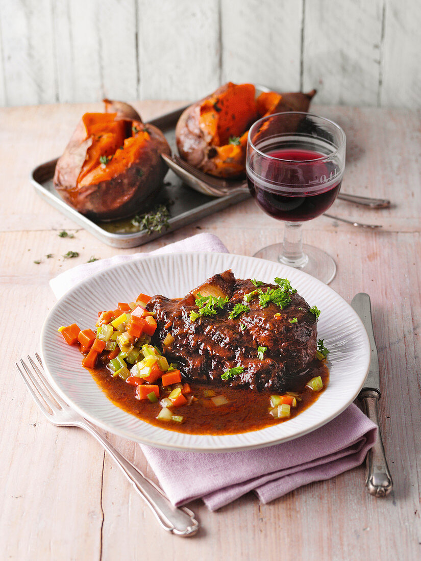 Lamb ossobuco with baked sweet potato and thyme-vanilla butter