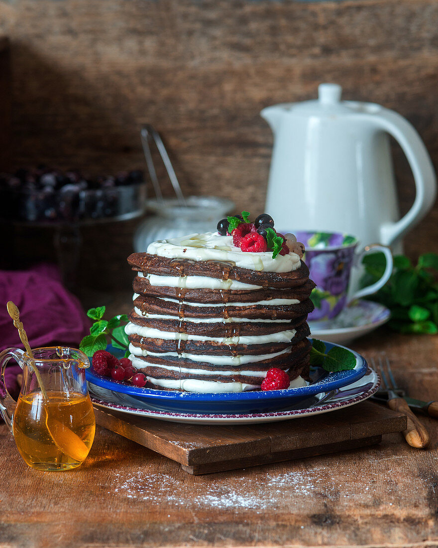 Chocolate pancakes with sour cream and berries