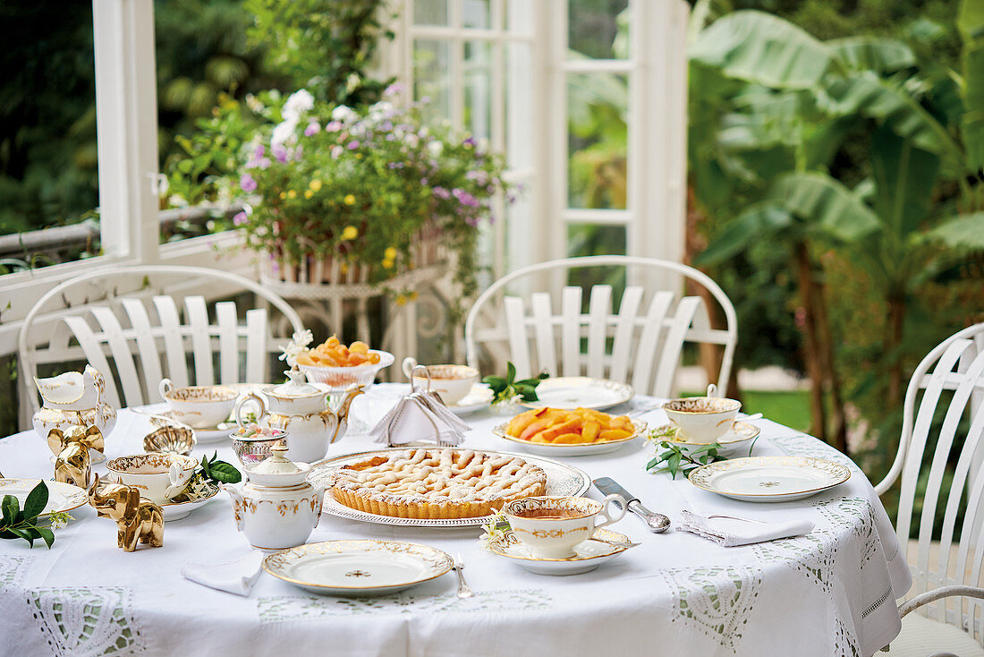 A table set for tea on the terrace with cakes and pastries