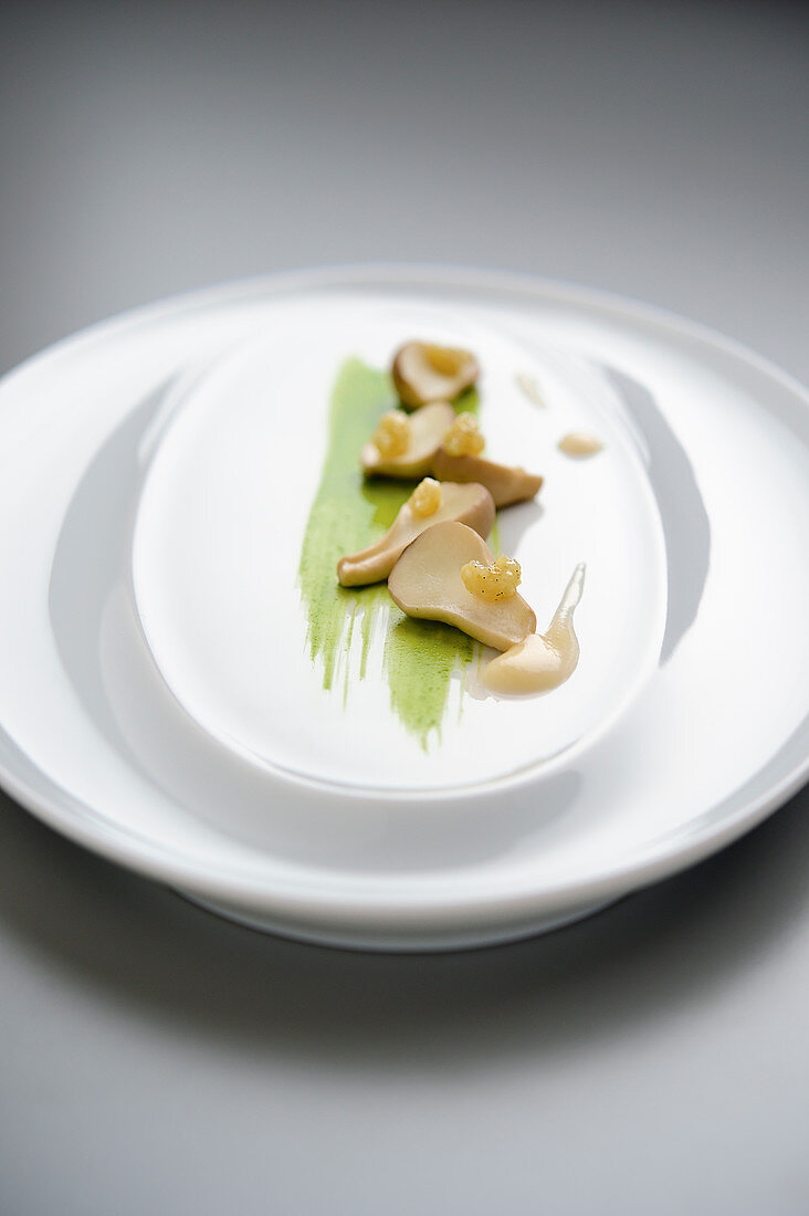 Pear-shaped puffballs with onion cream, parsley juice and garlic cream