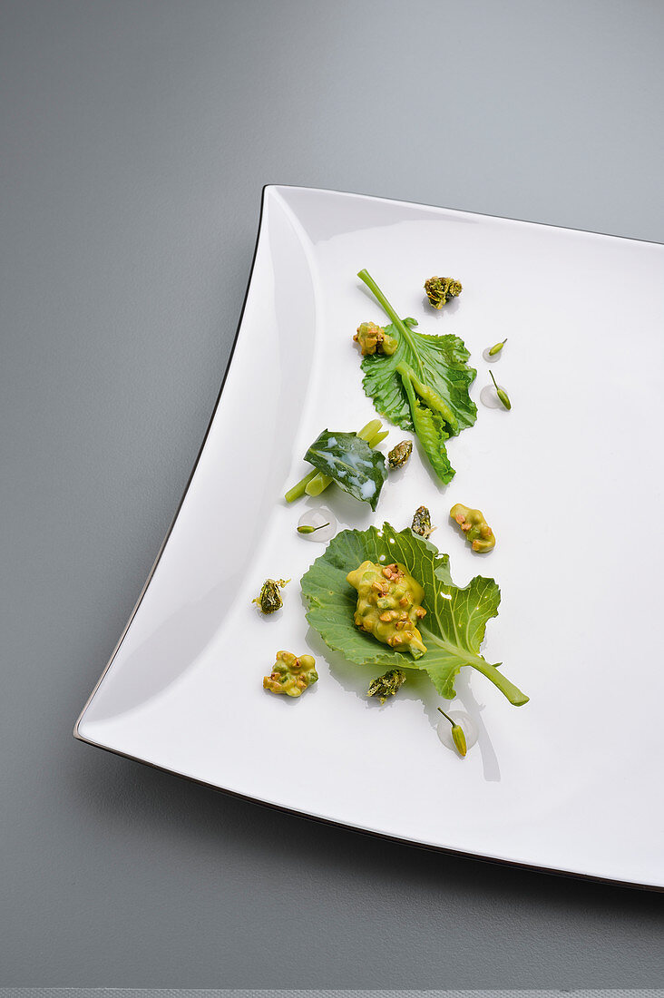 Overgrown white cabbage with pistachio cream and buckwheat